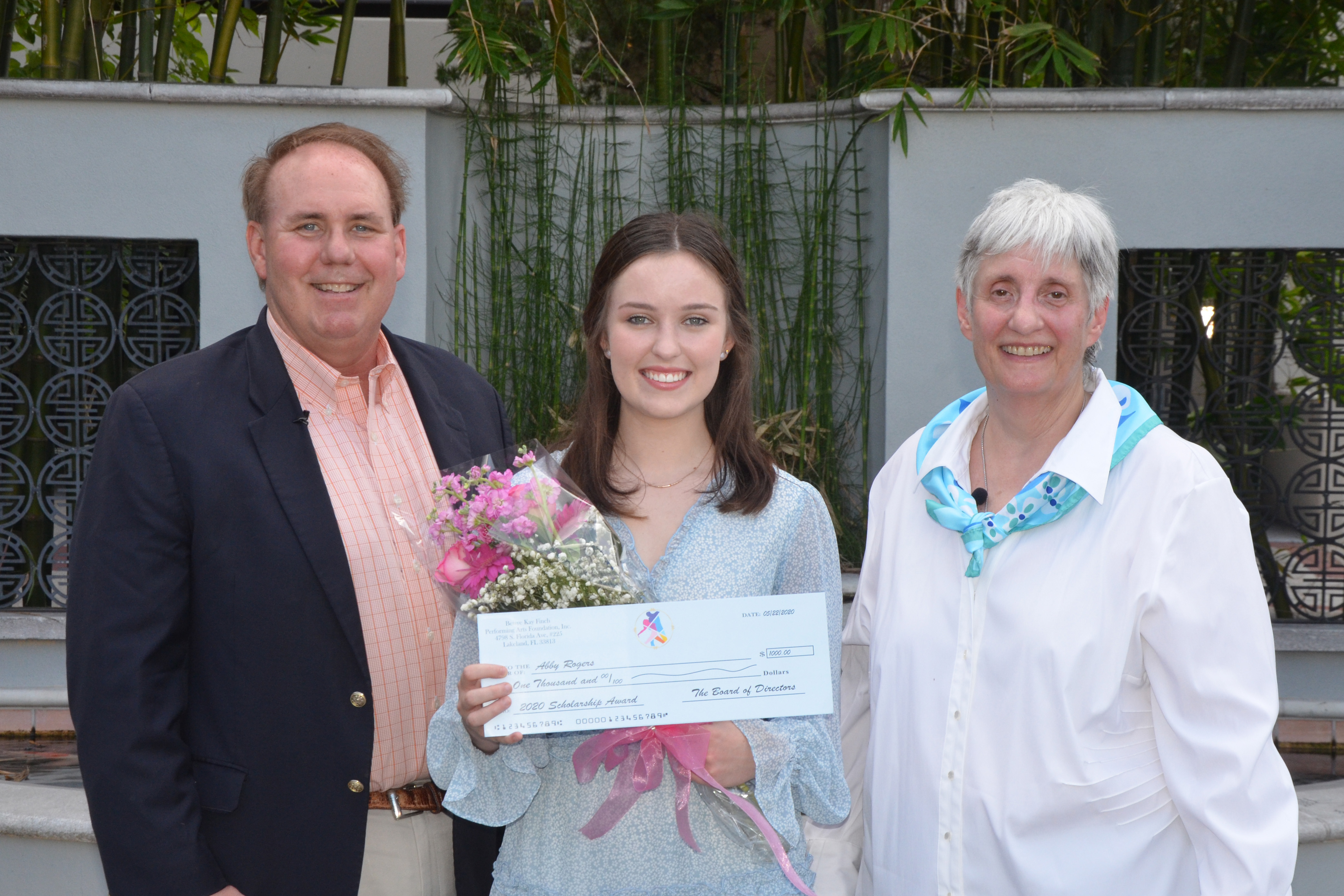 Abbey Rogers receiving scholarship from the Finchs