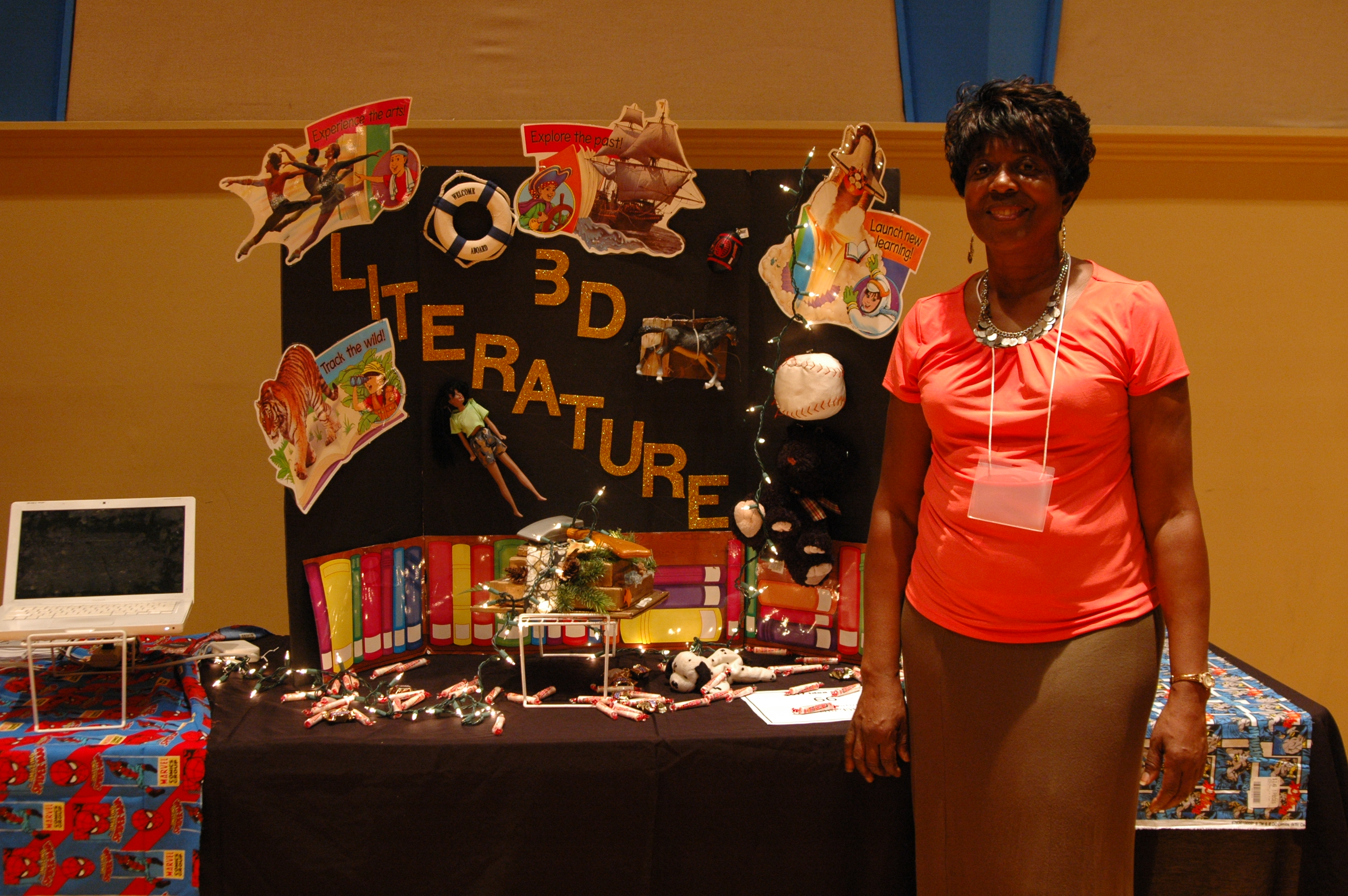 Woman standing in front of a poster board at a teacher to teacher event
