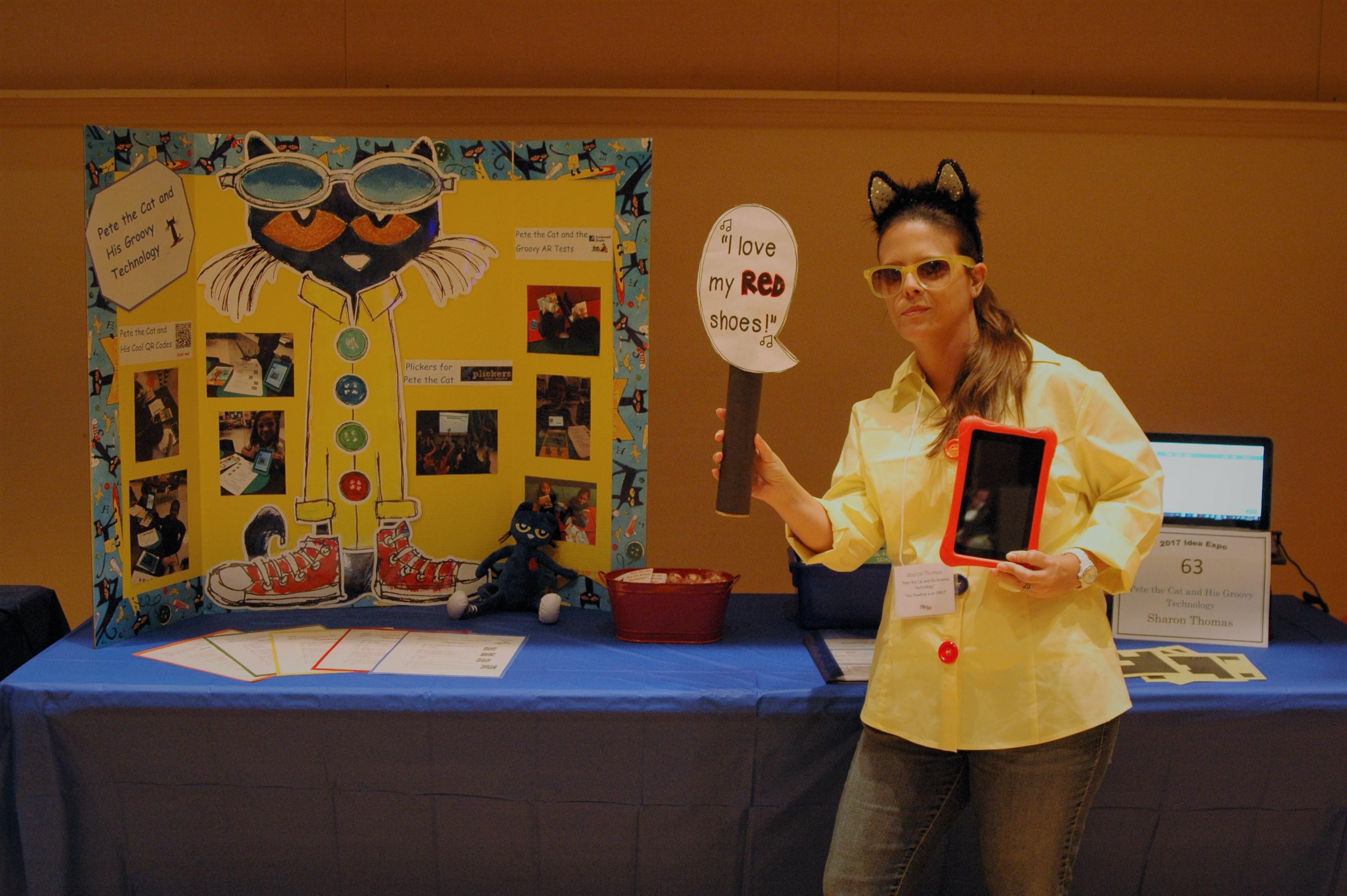 Woman holding sign at a teacher to teacher event