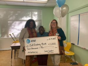 ATT STEM at Work Grant photograph with 3 women holding a check for 2,000 dollars