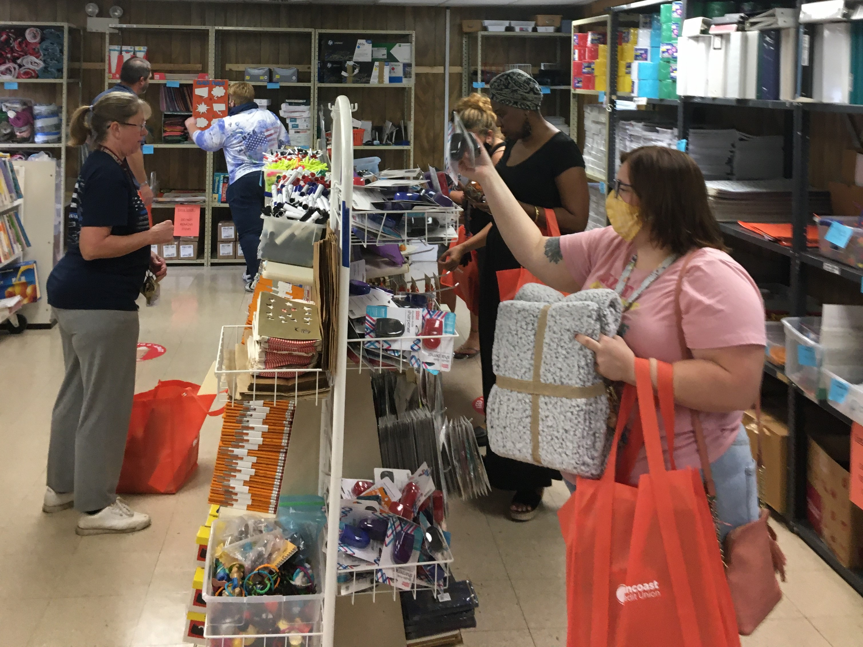 Teachers picking out items at the Free Teacher Market