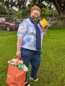 Teacher poses with supplies from the Free Teacher Market