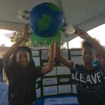 Two Girls holding up a Globe Project