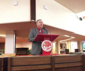 Michael Akes delivering a speech at Florida Southern College