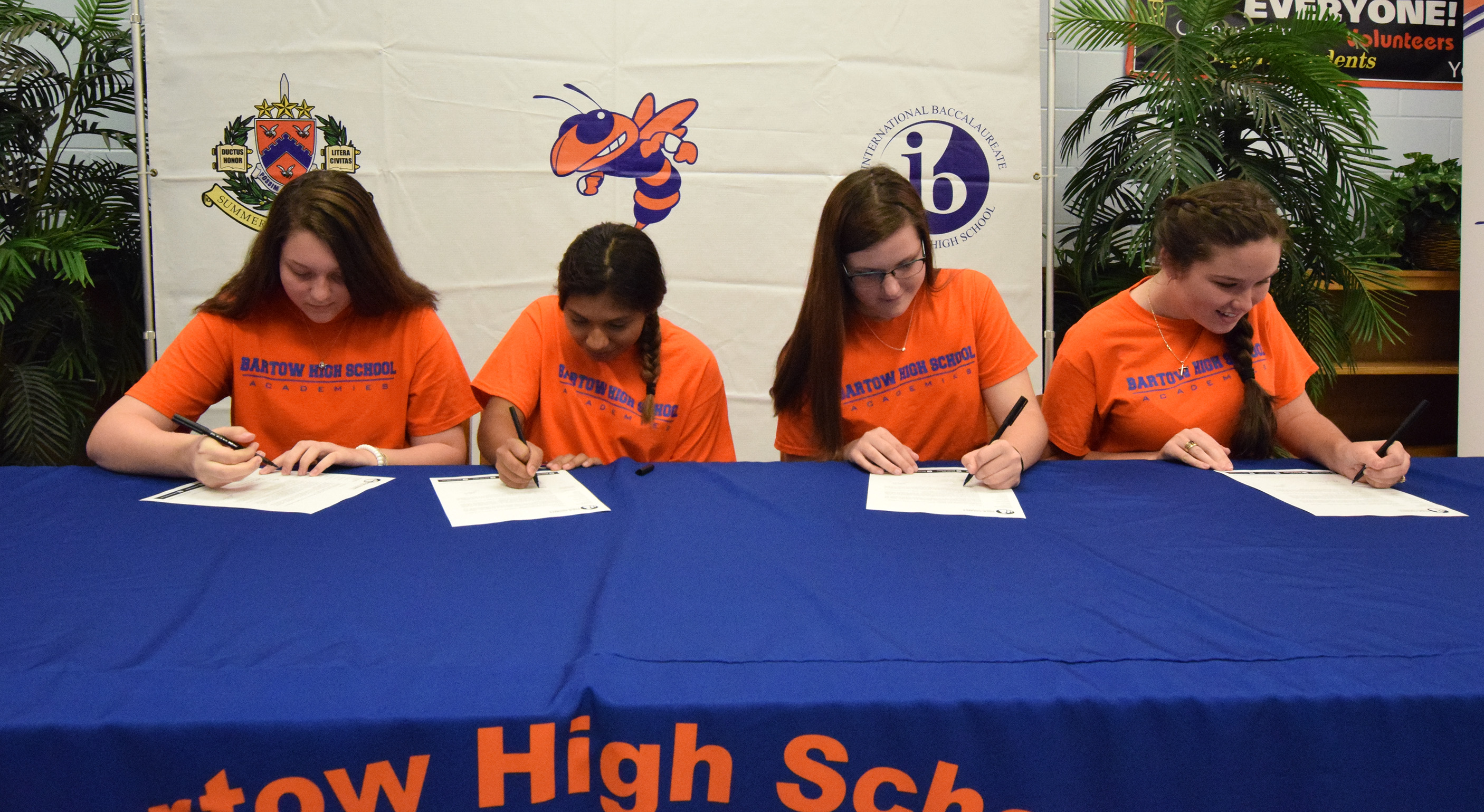 Bartow High students take part in a signing event for the ELITE teacher education program.