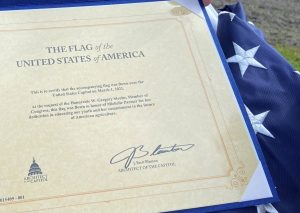 A flag and certificate presented to BMS teacher Michele Parmer