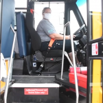 Photo of a PCPS bus driver wearing a medical mask