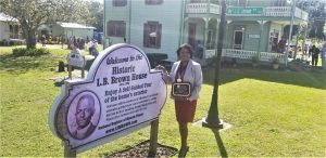 Superintendent Jacqueline Byrd with the L.B. Brown Legacy Award for outstanding community service