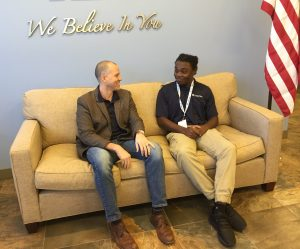 Winter Haven High junior Alonzo James (right) chats with James Spence, his mentor from CenterState Bank.