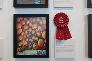 Connor Kennedy's artwork displayed with a red ribbon
