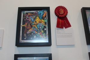 Renier Crespo's artwork displayed with a red ribbon