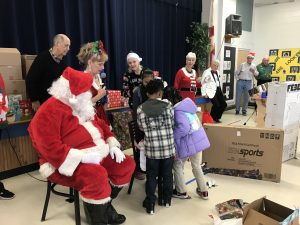 Students and families at Crystal Lake Elementary with Santa Clause