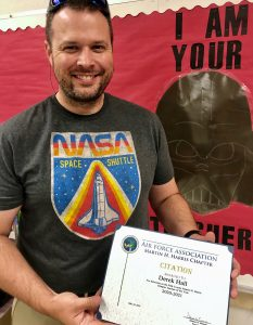 Derek Hall with his Teacher of the Year certificate