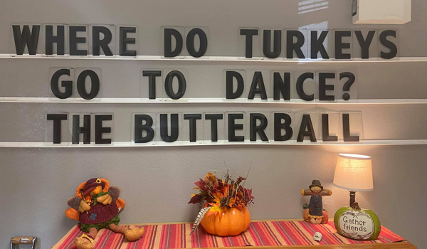 """Photo of a Thanksgiving display with the joke, """"Where do turkeys go to the dance? The butterball."""""""