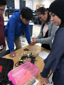 Students and parents work together on a craft project