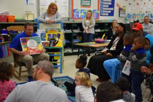 Volunteers reading to children during the early literacy event at Garner Elementary