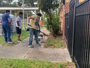 Lowe's employees cleaning up the PCPS Gibbons Street office
