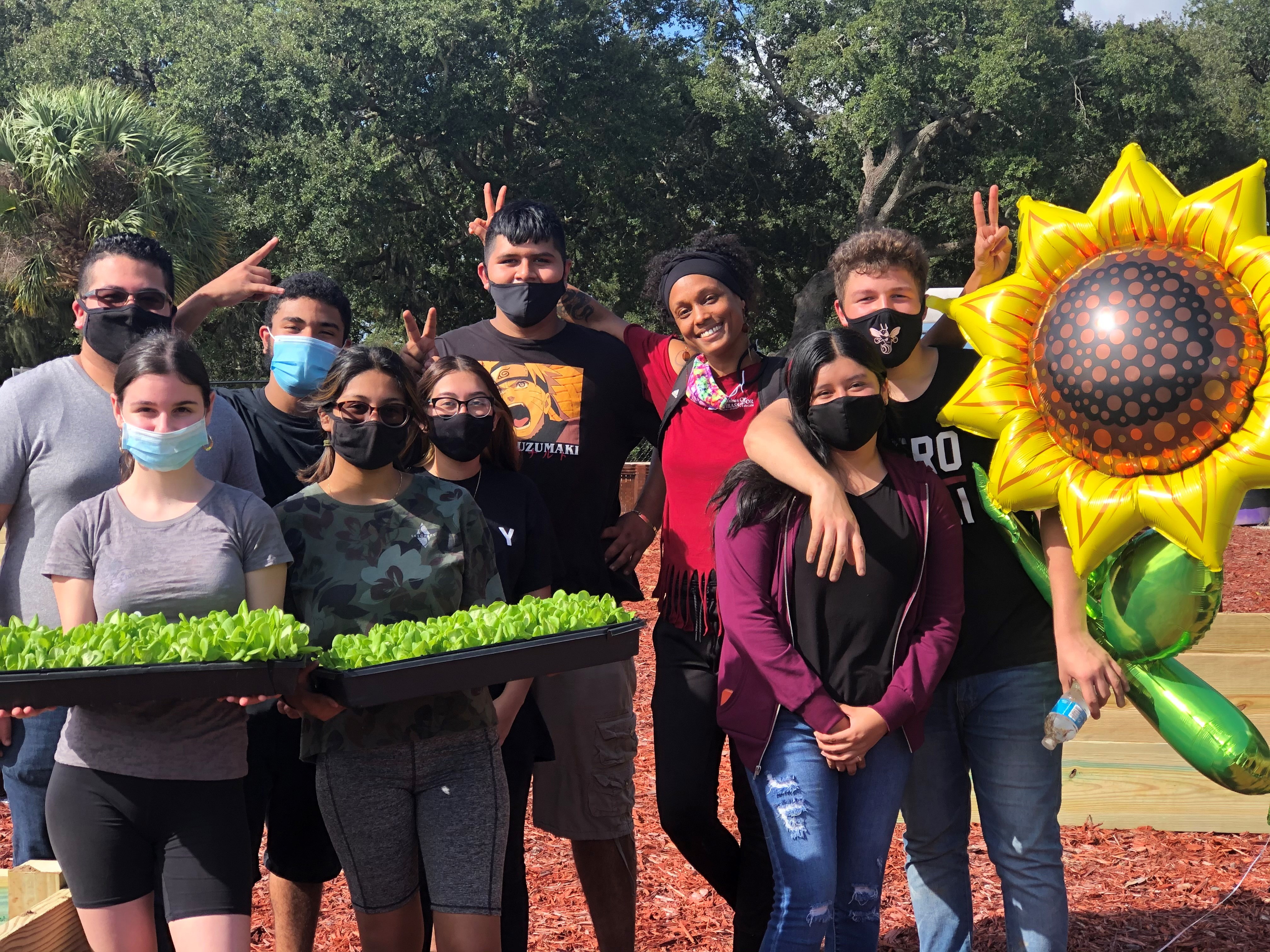 Photo of students working on the community garden in Haines City