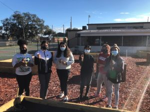 Students from Haines City High, Ridge Community High and Boone Middle planted the first seeds in the garden. From left: Maya Clermont, Alexsandra Arambula, Evelyn H., Aisha Garcia, Nereida Jorge and Aa'liyah Broaders.