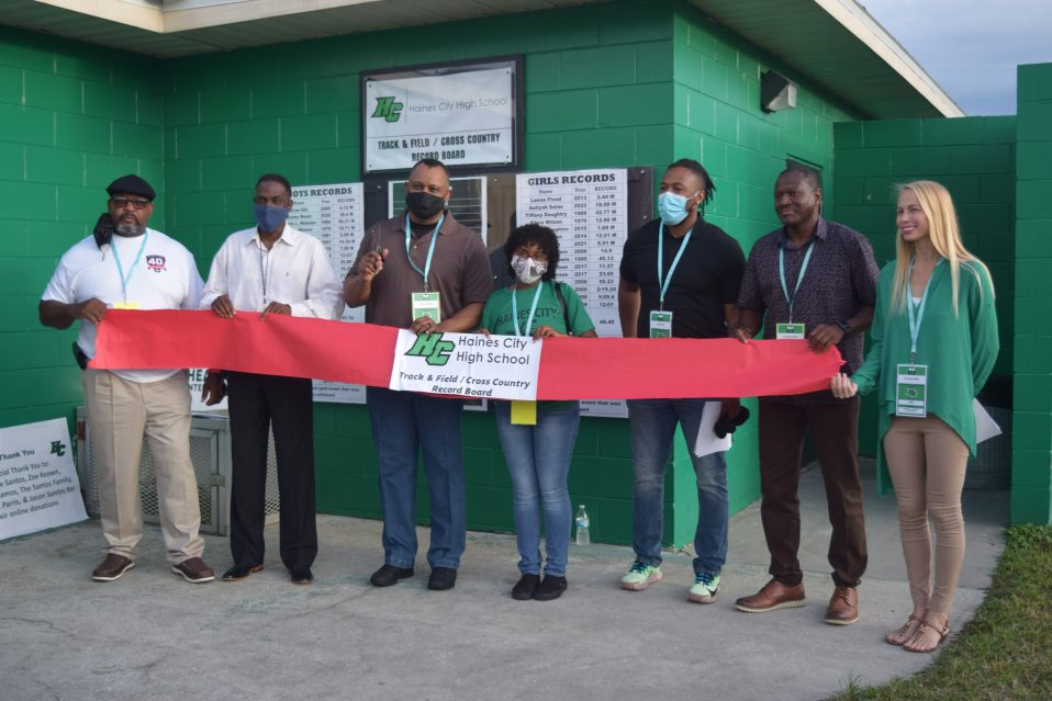 Ribbon cutting ceremony for HCHS' new record board