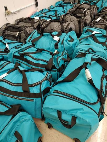 Photo of rolling duffle bags gathered by the Sunshine Committee