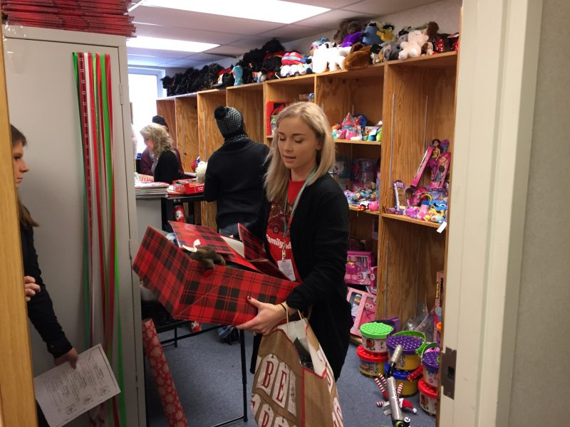 PCPS social workers gathering donated toys and clothing for students in need.