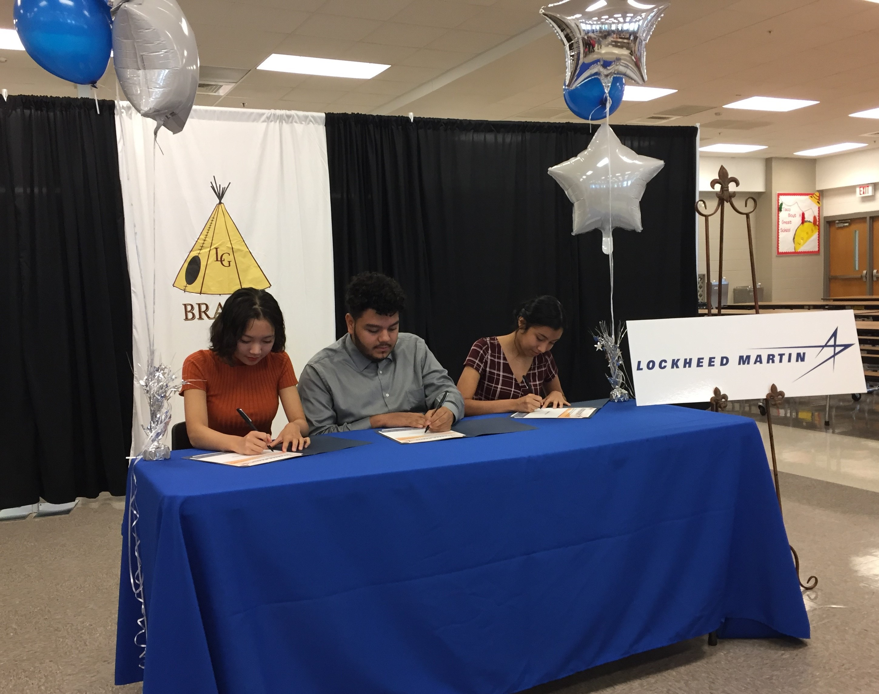 LGHS students at a signing ceremony for a new apprenticeship program with Lockheed Martin.