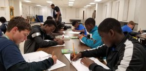Students doing their work in the mentoring program at Lake Gibson Middle