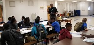 Ernest Joe speaks with students in the mentoring program at Lake Gibson Middle.