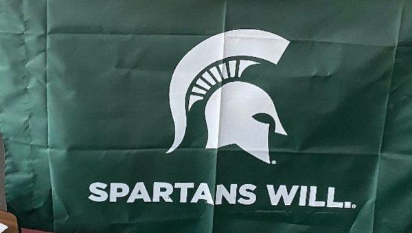 Photo of Mulberry High student with a Michigan State University flag