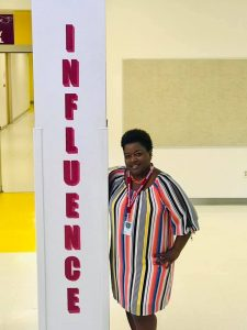 Principal Nikeshia Leatherwood stands next to one of the newly decorated pillars promoting Citrus Ridge's house system.