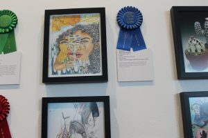 Winner Millie Ortiz's artwork displayed with a blue ribbon