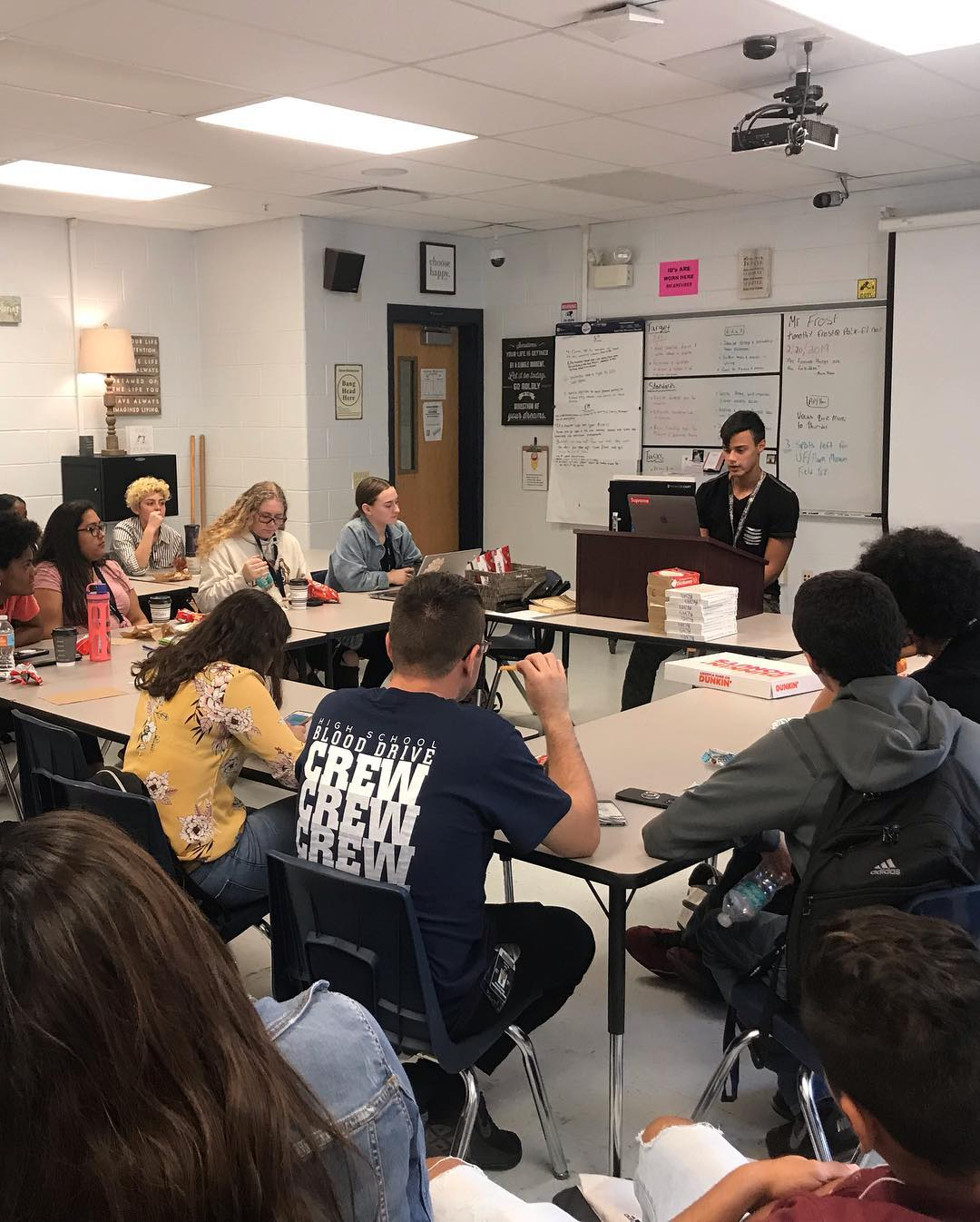 Students at Ridge Community High gather for a coffee house-style poetry reading.