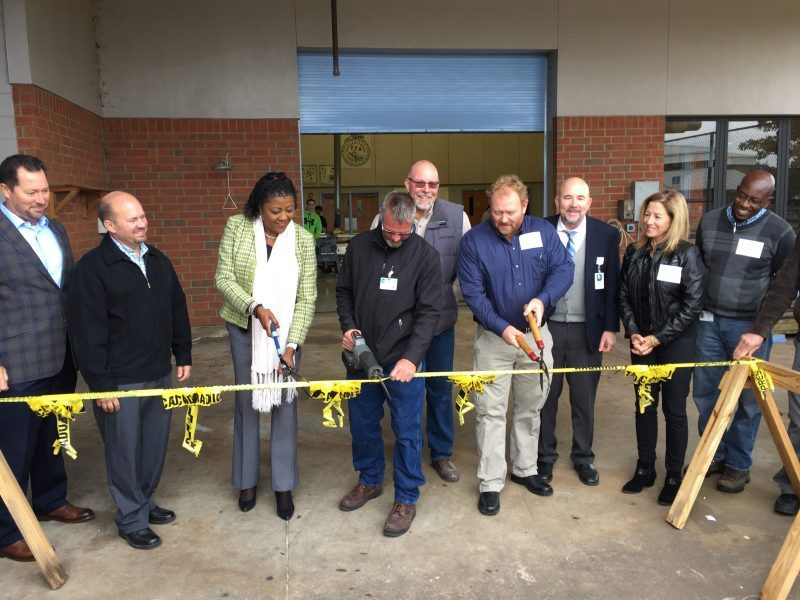 Polk County Public Schools officials hold a ribbon-cutting ceremony for a new construction program at Lake Region High.