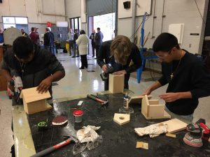 Students practicing basic measurement, cutting and tool skills in the new construction program at Lake Region High