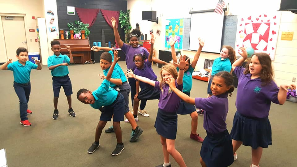 Students practicing a theatre exercise at Rochelle School of the Arts