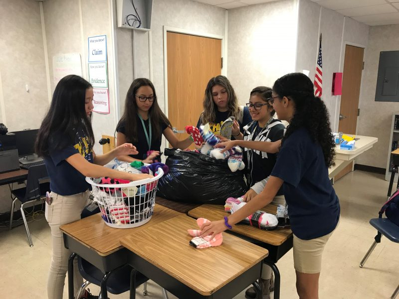 Lake Gibson Middle students sorting donating socks.