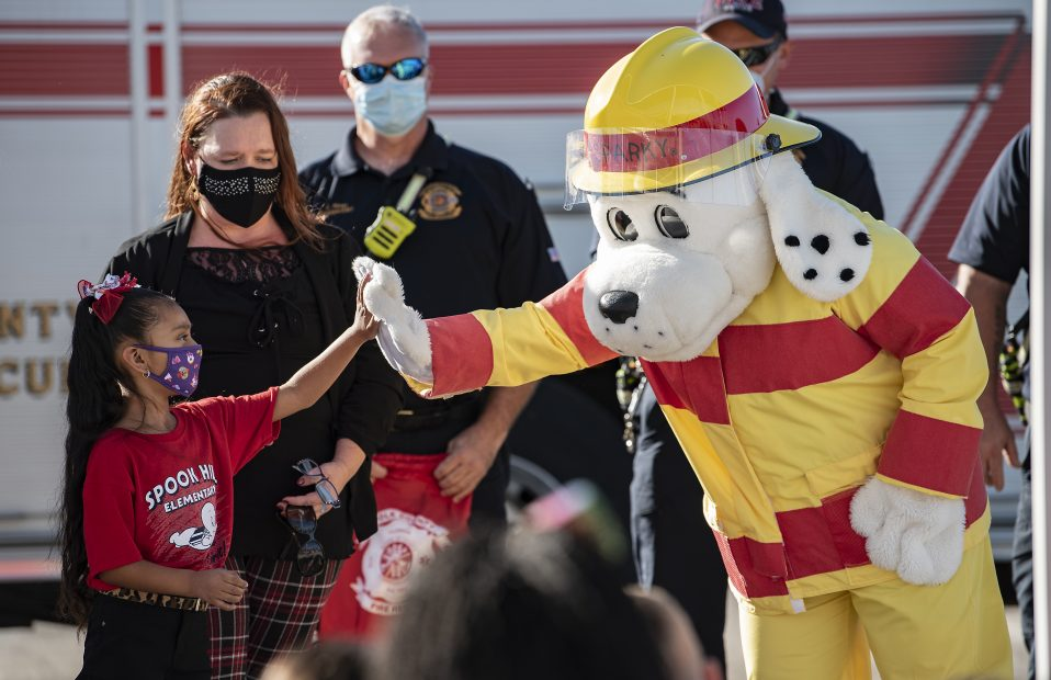 Esperanza Lopez with Sparky the Fire Dog