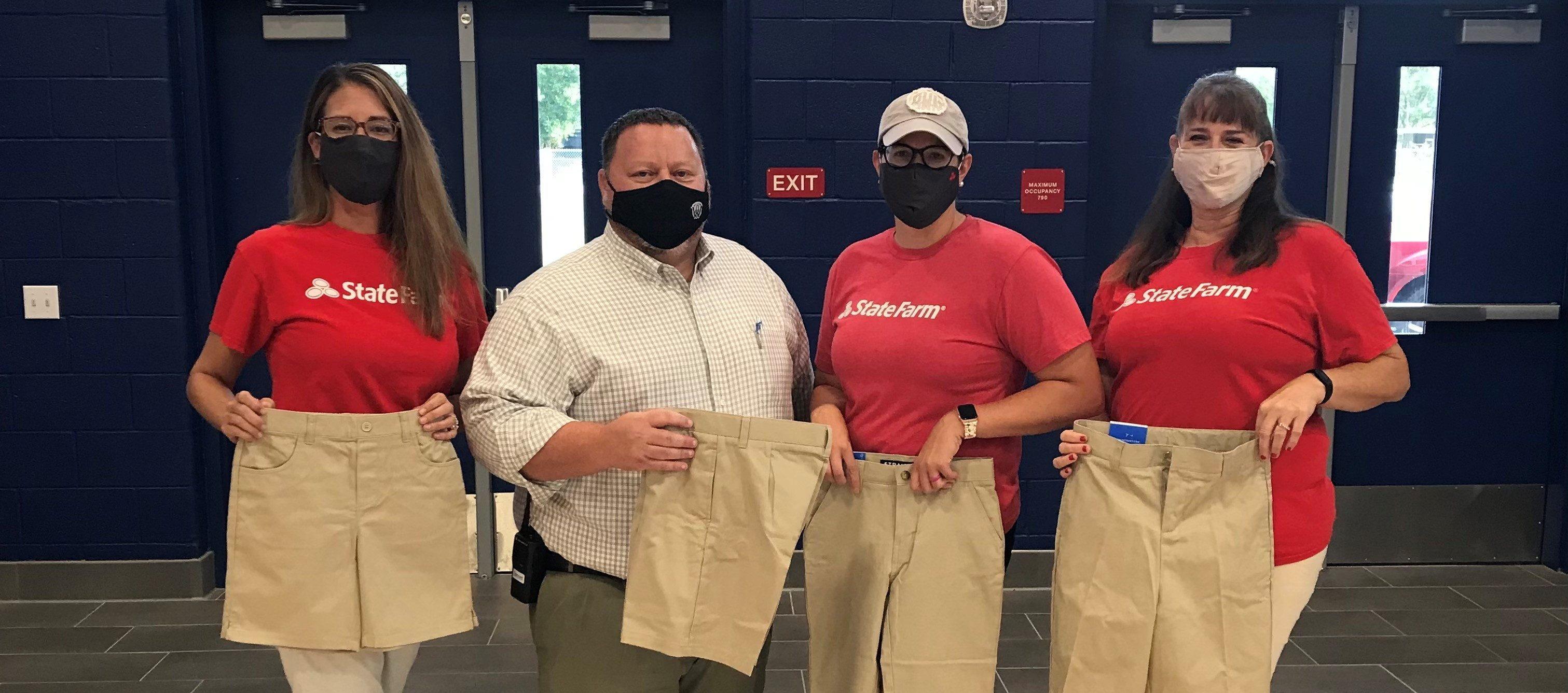 State Farm employees donating khakis to Westwood Middle