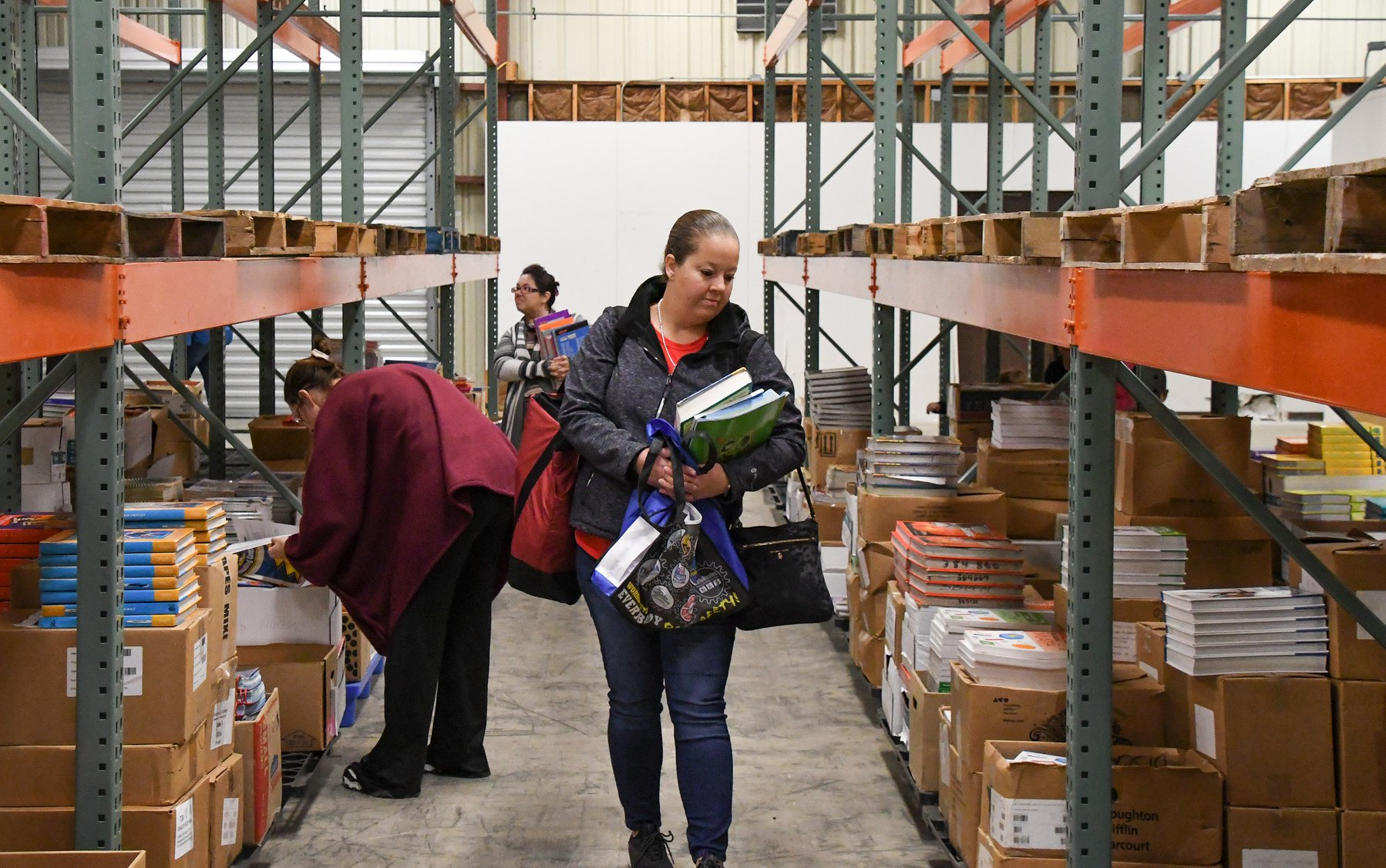 A photo of a woman browsing the surplus textbook warehouse.