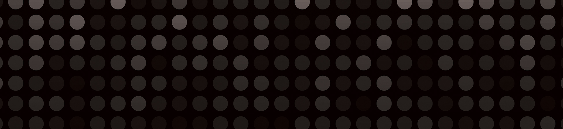 A black rectangle with faded white circles to form a textured background