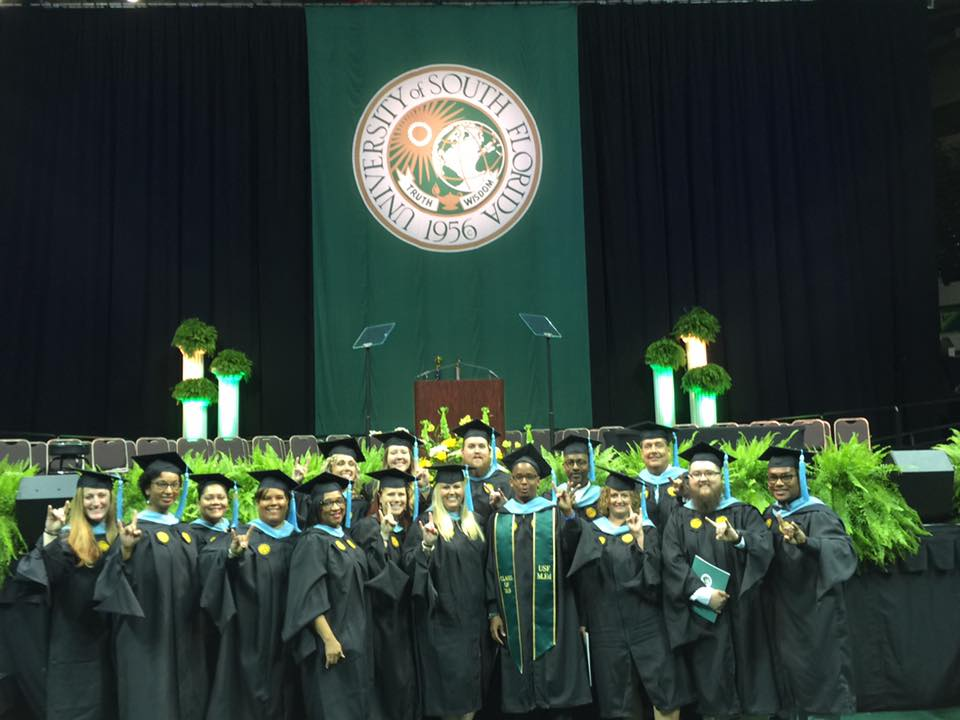 Kathleen High teachers graduating from USF pose for a group photo in front of the stage