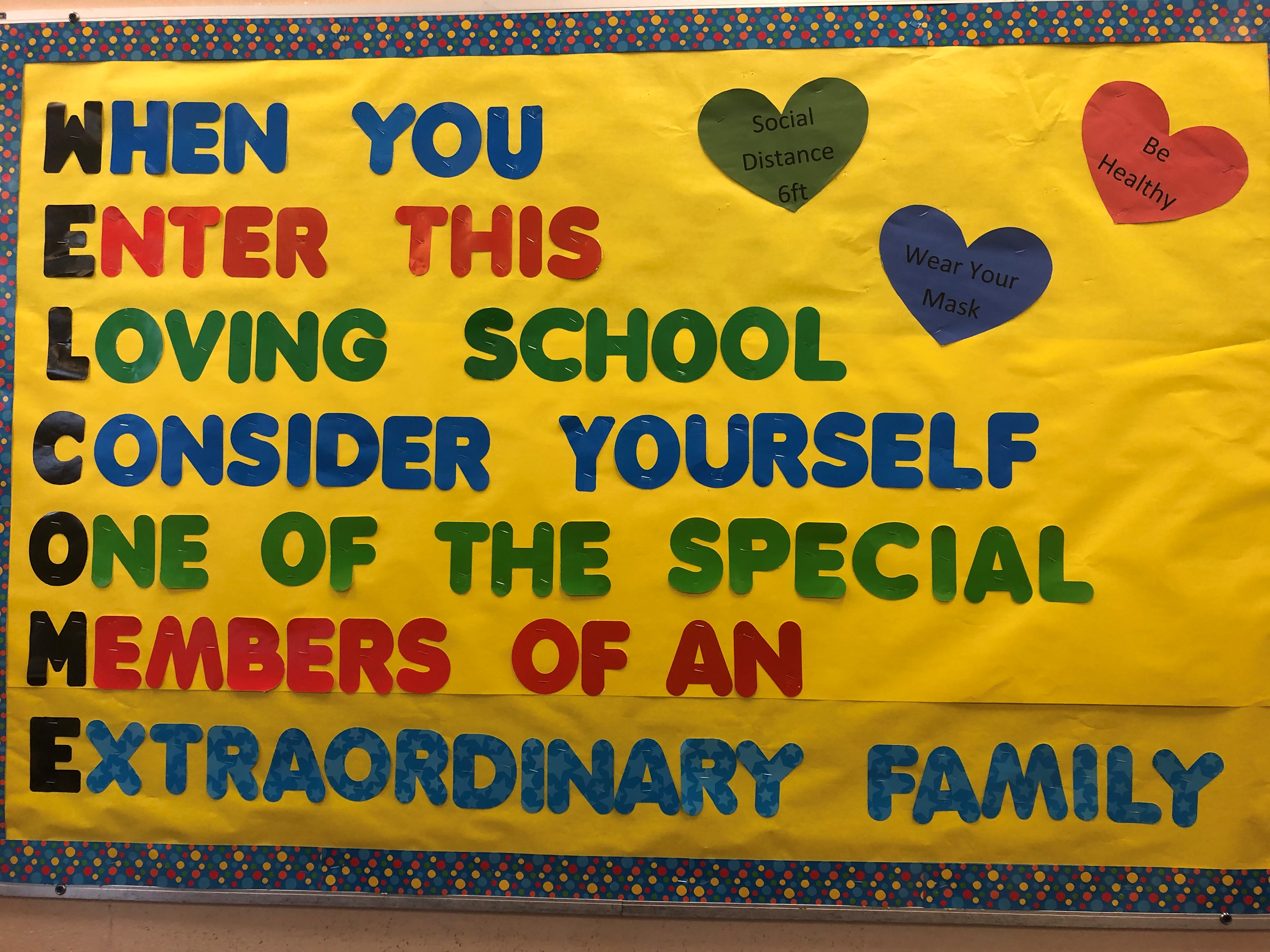 Photo of a bulletin board welcoming students.
